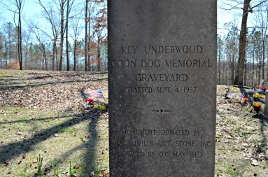 A monument donated by Russellville Cut Stone stands in the Key Underwood Coon Dog Memorial Graveyard, better known as the Coon Dog Cemetery. (Anne Kristoff / Alabama NewsCenter)