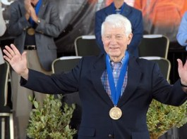 Astronaut Henry Hartsfield (1933-2014) waves to the crowd after his induction into the United States Astronaut Hall of Fame at Kennedy Space Center in Cape Canaveral, Florida, in May 2006. (From Encyclopedia of Alabama, photo courtesy of NASA)