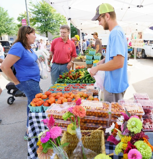 Andrew Kesterson sells produce, flowers and herbs grown at Belle Meadow Farm in Tuscaloosa. (Mark Sandlin/Alabama NewsCenter)