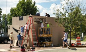 Crews worked to quickly build a giant Amazon box at Railroad Park prior to the BringAtoB press conference today. (Dennis Washington / Alabama NewsCenter)