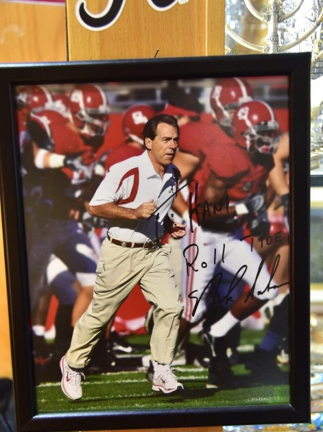 An autographed picture of Alabama coach Nick Saban is proudly on display in Hani Imam's shop in Jerusalem. (Karim Shamsi-Basha / Alabama NewsCenter)