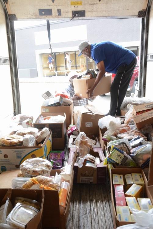 A worker loads a truck with healthy food to be distributed. (Karim Shamsi-Basha/Alabama NewsCenter)