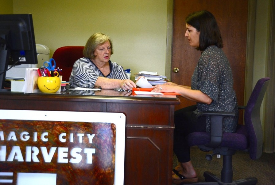 Carlye Dudgeon and Ann Wallace work at the Magic City Harvest office. (Karim Shamsi-Basha/Alabama NewsCenter)