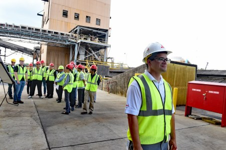 Process engineer Jason Arriazola, right, was one of 19 Southern Company employees involved in hosting IEAGHG visitors to the National Carbon Capture Center. (Wynter Byrd / Alabama NewsCenter)