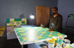 Farwell uses paint, tapem and a box cutter to create quilt squares in his studio. (Anne Kristoff/Alabama NewsCenter)