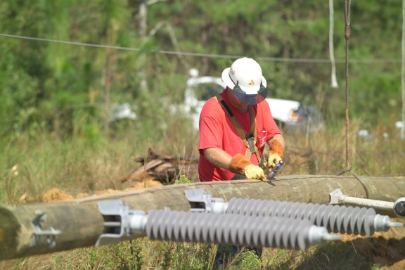 A lineman works to restore power following Hurricane Ivan. (File)