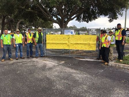 Alabama Power crews stand next to sign of appreciation from children at Palmetto Charter School. . (contributed)