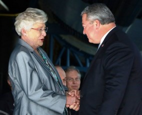Gov. Kay Ivey greets Commerce Secretary Greg Canfield at a project announcement for Blue Origin, which is building a $200 million rocket engine factory in Huntsville. (Jamie Martin/Governor's Office)