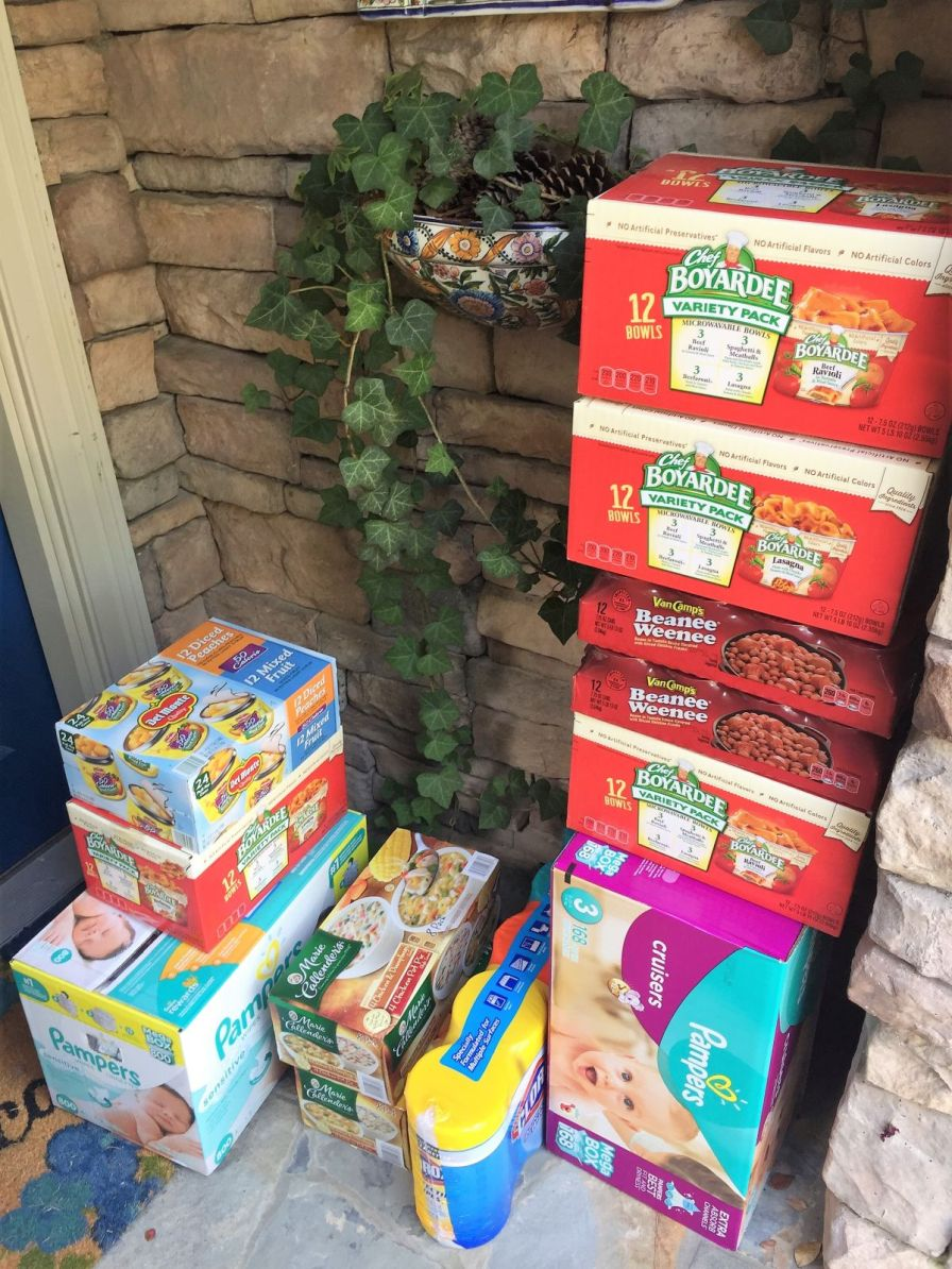 Friends stacked donations at Robert's home. (Donna Cope/Alabama NewsCenter)