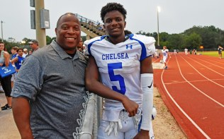 Miles College Head Football Coach and proud father Reginald Ruffin supports his son, Gabriel, at the Chelsea High School freshman's first game of the season. (Solomon Crenshaw Jr./Alabama NewsCenter)