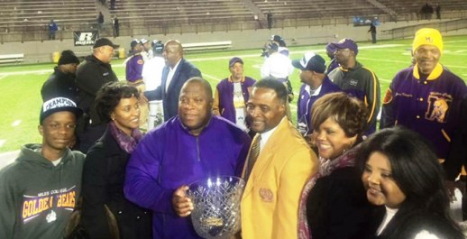 The Ruffin family and others with Miles College President George French, in yellow jacket. Reginald Ruffin says French has been an important source of support for him during the loss of his wife, Monica, to cancer this year. (Contributed)