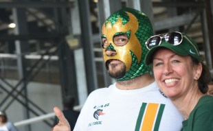 """Rich Mansfield portrays """"Bernie Masked Man"""" on his monthly comedy talk show. He opted for the green and gold dragon style to be part of the atmosphere at UAB games. His wife Sara works in research in the UAB School of Health Professions. (Solomon Crenshaw Jr. / Alabama NewsCenter)"""