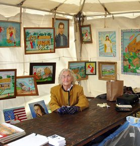 Myrtice West is seen in her booth at the 2006 Kentuck Festival of the Arts in Northport, Tuscaloosa County. (From Encyclopedia of Alabama)