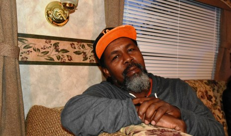 Rosedale's Anthony Montgomery relaxes in his RV on Tuesday night, having already claimed his spot for Magic City Classic tailgating. (Solomon Crenshaw Jr. / Alabama NewsCenter)