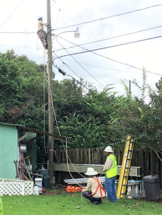 Alabama Power crews work to restore power in the Meadowbrook area of Mobile. (Denise Curtis)