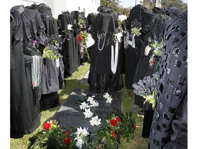 The Merry Widows are a part of the annual Joe Cain Day celebration. The women dress as mourning widows and gather at Joe Cain's graveside in Mobile's Church Street Graveyard. (From Encyclopedia of Alabama, courtesy of The Mobile Press-Register)