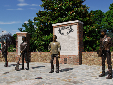 Bronze statues of the members of the music group Alabama greet visitors to the city park in Fort Payne, DeKalb County, the band's hometown. (From Encyclopedia of Alabama, courtesy of Alabama Tourism Department)