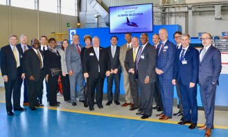 Commerce Secretary Greg Canfield and other Alabama officials pose with executives from Leonardo and its partners on the T-100 project during a tour of the Leonardo aircraft factory. (Made in Alabama)