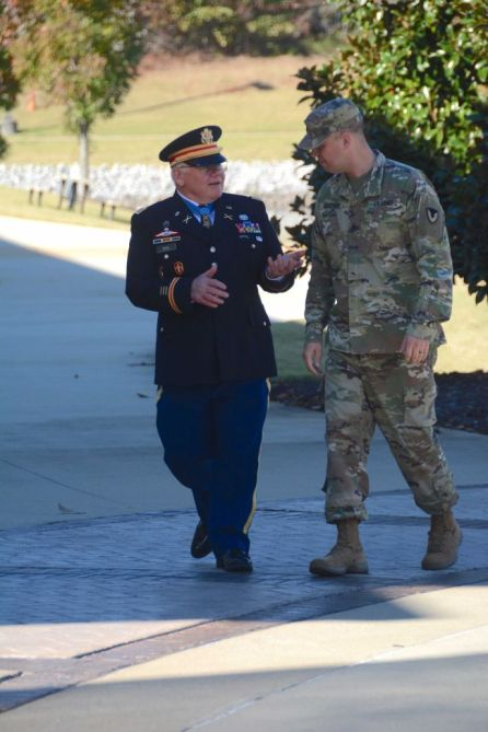 Retired Capt. Gary Rose chats with Sgt. Eben Boothby. (Karim Shamshi-Basha/Alabama NewsCenter)