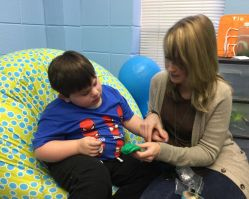 A teacher's aide helps a student. (Donna Cope/Alabama NewsCenter)