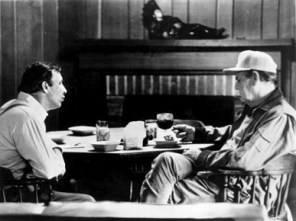 """University of Alabama football coaches Pat Dye, left, and Paul """"Bear"""" Bryant converse over dinner at a hunting lodge in Greene County in 1972. (From Encyclopedia of Alabama, courtesy of The Doy Leale McCall Rare Book and Manuscript Library, University of South Alabama)"""