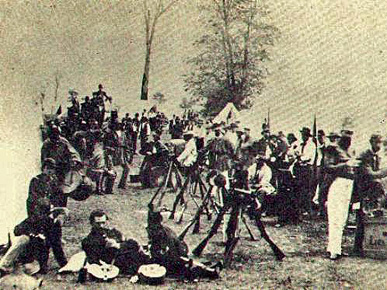 Confederate colonel John Hunt Morgan and members of his unit, the 2nd Kentucky Cavalry Regiment, relax at an unnamed camp in Kentucky in 1862 during the Civil War. The force, known as Morgan's Raiders, destroyed communication and transport systems throughout Tennessee and Kentucky and captured hundreds of Union soldiers. (From Encyclopedia of Alabama, courtesy of the City of Paris, Kentucky)
