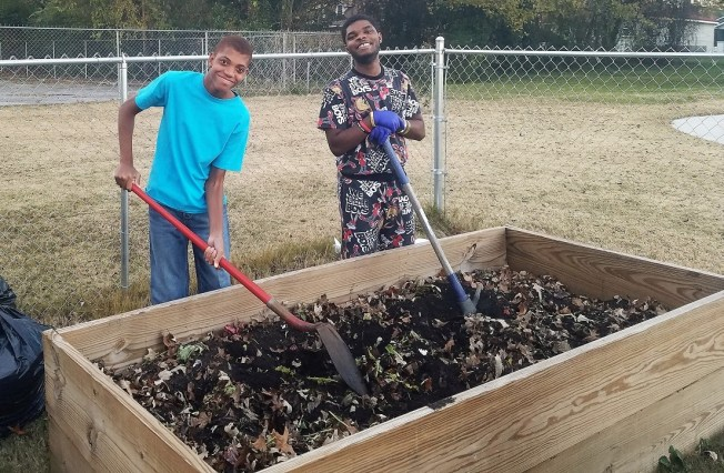 Gadsden students work on the garden that supplies vegetables for their Beautiful Rainbow Café. The restaurant and academic program has succeeded in teaching special needs students concepts they had difficulty grasping in a normal classroom setting. (Contributed)