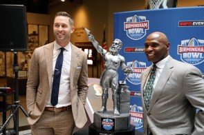 Texas Tech coach Kliff Kingsbury, left, will lead his team against Charlie Strong and South Florida in the Birmingham Bowl on Saturday. (Birmingham Bowl)