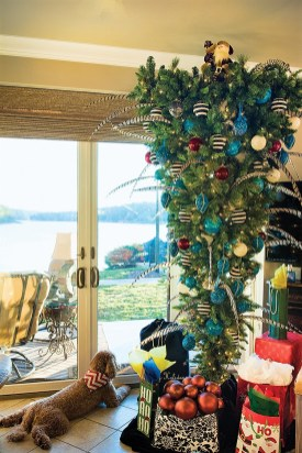 Billings and Hurley decided to maximize space and do something creative at their Smith Lake home by positioning their Christmas tree upside down. (Phil Free / Shorelines)