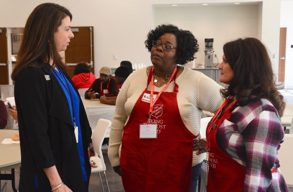 The Salvation Army's Lori Cork, left, talks with volunteers Rikesha Foster and Wendy Malone at the organization's Thanksgiving lunch. (Karim Shamsi-Basha / Alabama NewsCenter)