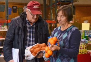 Martha Henk, right, tries to recapture some of the estimated 39 percent of food in the U.S. that's wasted each year and redirect it to hungry people in east Alabama. (Karim Shamsi-Basha / Alabama NewsCenter)