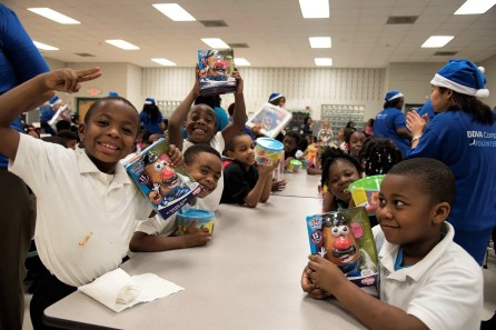 The children at South Hampton K-8 School show off their new toys courtesy of BBVA Compass' Project Blue Elf. (Brittany Faush / Alabama NewsCenter)