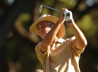 Hubert Green hits from the 18th tee during the first round of the Champion's TOUR 2005 SBC Championship at Oak Hills Country Club in San Antonio, Texas Oct. 21, 2005. (Photo by Steve Grayson/Getty Images)