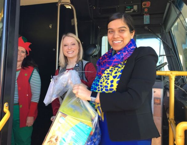 Chitra Kirpalani (right) helped pass gifts along to Salvation Army elves. (Donna Cope/Alabama NewsCenter)