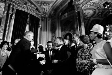 President Lyndon B. Johnson meets with Martin Luther King Jr. at the signing of the Voting Rights Act of 1965. (Lyndon Baines Johnson Library and Museum, Wikipedia)