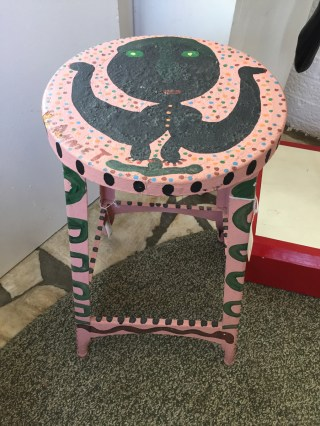 Painted stool by Annie Tolliver. (Anne Kristoff / Alabama NewsCenter)