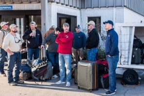 Bags are packed and crews prepare to board the plane to Puerto Rico. (Nik Layman/Alabama NewsCenter)