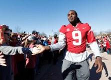 Alabama running back Bo Scarbrough (9) celebrates with fans. (Amelia B. Barton)