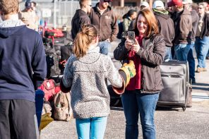 Family members take pictures before saying goodbye to crews. (Nik Layman/Alabama NewsCenter)