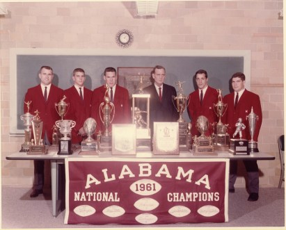 "Coach Paul ""Bear"" Bryant and other coaches mark the first of his six national championships at Alabama in 1961. (Contributed)"