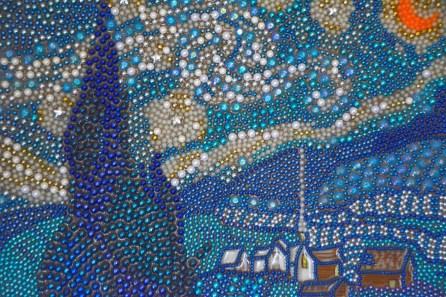 Mardi Gras beads give McCarron's paintings a distinctive texture. (Karim Shamsi-Basha / Alabama NewsCenter)
