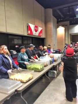 Scenes from Heart to Table program to feed the homeless on cold nights at Boutwell Auditorium in Birmingham. (Karim Shamsi-Basha / Alabama NewsCenter)