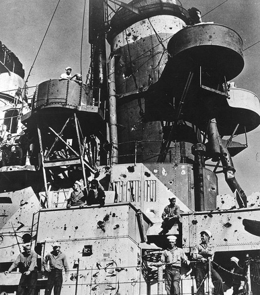 Damage to the USS Birmingham (CL-62), caused when USS Princeton (CVL-23) blew up during the Battle of Leyte Gulf on Oct. 24, 1944. The USS Birmingham was alongside the Princeton, assisting with firefighting, when the carrier's after bomb stowage detonated, showering Birmingham with fragments and causing heavy casualties among her crew. (Catalog #: NH 98128, Archives Branch, Naval History and Heritage Command, Washington, DC)