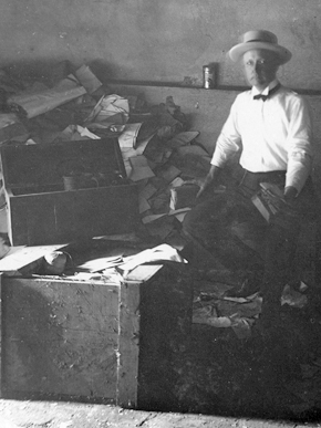 Thomas M. Owen in the basement of the Alabama capitol in Montgomery, ca. 1910. The Alabama Department of Archives and History, which Owen founded, was housed in the cloak room from 1901 until 1903, when it was moved to a new wing of the capitol building. (From Encyclopedia of Alabama, courtesy of Alabama Department of Archives and History)