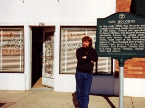 Music producer Sam Phillips poses before Sun Records in Memphis, Tennessee, which he founded in 1952. (From Encyclopedia of Alabama, courtesy of the Alabama Music Hall of Fame)