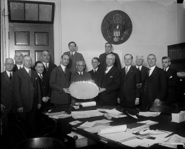 Rep. Lister Hill of Alabama (left) is presented with a silver service tray, as a gift for his marriage to Henrietta McCormick, by Rep. John J. McSwain of South Carolina, on behalf of the members of the House Military Affairs Committee, Feb. 28, 1928. (Photograph by Harris & Ewing, Library of Congress Prints and Photographs Division)