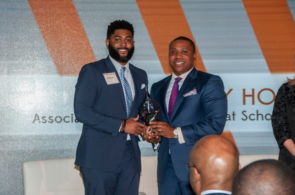 Dr. Anthony Hood of UAB, left, receives a Power of Leadership award from Jonathan Porter, vice president of the Birmingham Division of Alabama Power. (Billy Brown / Alabama NewsCenter)
