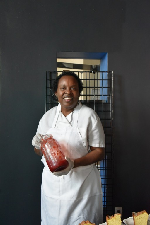 Highlands pastry chef Dolester Miles with a jar of her strawberry preserves. (Brittany Faush/Alabama NewsCenter)