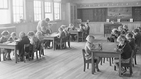 First grade children and teacher at the Goodman School, Coffee County, 1939. (Photograph by Marion Post Wolcott, Library of Congress Prints and Photographs Division)