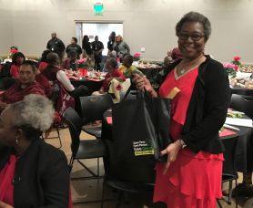 Rice was among about 30 attendees who won a door prize. (Donna Cope/Alabama NewsCenter)
